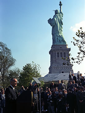 Lyndon B. Johnson speaking on Immigration Acto of 1965 near Statue of Liberty