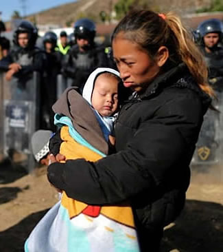 migrant caravan mother and child after being tear gassed by US military and border patrol