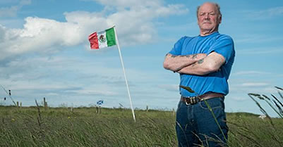 A Mexican flag is raised in protest near Trump's golf course In Scotland