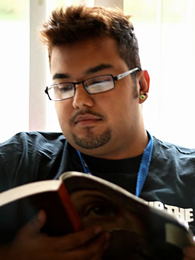 young Latino student reading